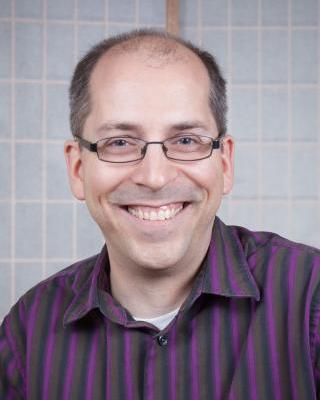 headshot of Brett Groff smiling