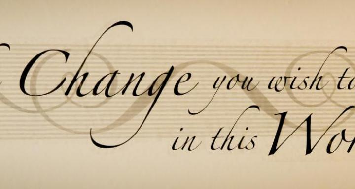 "quote on a beige background from ghandi, ""Be the change you wish to see in this world"""